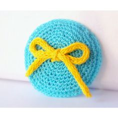 Turquoise circle with yellow bow crocheted brooch by ArigigiArt via Polyvore