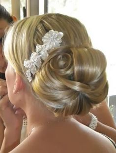 Large low bun with flower accessory