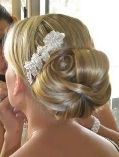 Large low bun with flower accessory bun hairstyles, weddings, hair pieces, hair designs, hair beauty, bridal hairstyles, wedding hairs, hair style, hair combs