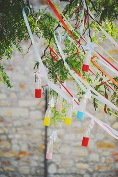 hanging bottles with painted bottoms, photo by L&V Photography http://ruffledblog.com/colorful-italian-wedding #weddingideas #decor #weddingdecorations