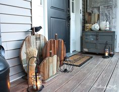 Fall Front Door with Reclaimed Wood Pumpkins Cute idea in large porch size or smaller indoor decor size.
