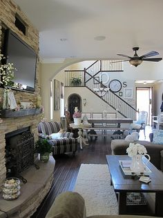 Gorgeous family room....and I love the stone fireplace!