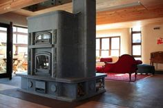 """Gilgan straw bale, super green home.  The massive, $25,000 soapstone fireplace, says Mr. Gilgan, was a joy to watch go together. Plates of stone were """"stacked to make this weavin..."""