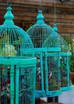 Birdcages from antique shops spray paint a bright color add flowers and put outside as decor.