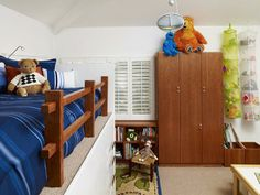 This boys' room has plenty of storage, from the built-in closet and bookshelf to the drawers underneath the loft-style bed.