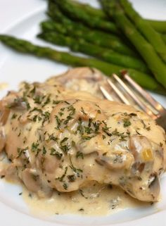 Julia Childs Chicken Breasts with Mushrooms and White Wine Cream Sauce ~ WARNING: If you make this dish, you may be tempted to lick the remaining sauce from the pan! The mushroom and cream sauce that smothers the chicken breasts in this recipe is so divine!