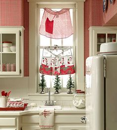 Aprons as window treatments!  Cute!  (& gingham wallpaper)