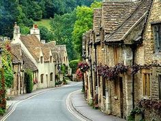 """THE COTSWOLDS: Are Popular with the English as well as visitors from all over the world, it's sleepy stone cottage villages, thatched roofs, and drystone walls represent an important historical landscape as well as a major conservation feature. Most of the building stone is local honey-coloured oolithic limestone, which has ensured that the area has a magical uniformity of architecture.  During the medieval period, the native """"Cotswold Lions"""" {sheep} were known for their heavy fleeces and high quality wool, which commanded high prices, the wealth generated by their trading enabled the wool merchants to leave their mark by building fine houses and wonderful churches, known as the wool churches. Even today, the sight of sheep on the hillside is still one of the classic Cotswold images."""