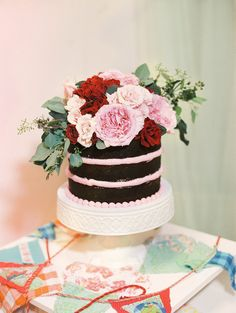 chocolate naked wedding cake, photo by Ashley Goodwin http://ruffledblog.com/kate-spade-inspired-wedding-in-hawaii #weddingcake #cakes