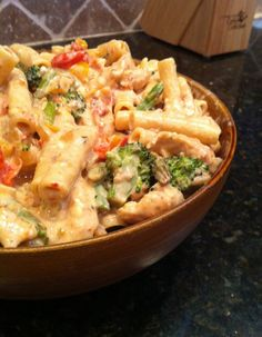 Confetti Chicken -- pasta, chicken, salt/pepper, onion, garlic, peppers, brocoli, asparagus, grape tomatoes in a cheesy, spicy sauce.