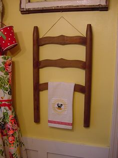back of an old ladderback chair hung on wall to hang towels, pictures, signs, etc. ladder, modern chairs, towel racks, antique furniture, kitchen towels, kitchen chairs, chair backs, bathroom, old chairs