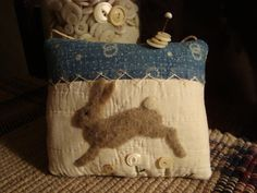 """Old Quilt Rabbit Pinkeep - love the bunny design - not sure if it's felted, but a really cute idea! Could make it """"scenic"""" by using a greenish fabric instead of the muslin, and embroidering a few little flowers on the """"horizon"""". Would make a wonderful pillow design!"""