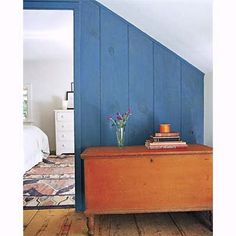Complements: Orange and Blue. The cool blue milk paint on this wall accentuates the bright burst of orange on the blanket chest in front of it. | Choose Paint Colors With a Color Wheel | thisoldhouse.com
