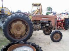 Antique Massey Ferguson 50 tractor salvaged for used parts. Call 877-530-4430 for the best used ag parts. http://www.TractorPartsASAP.com