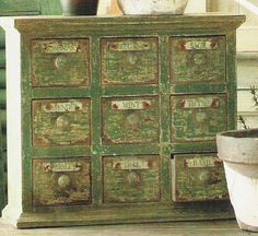 love the green weathered paint and the many little drawers.
