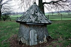 Whimsical tree stump. What a great way to incorporate that old stump into the landscape... a few plantings and it is a gnome or faerie house :)