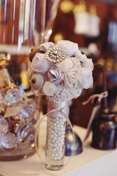 Pearls in flower vase. Adds a classy touch. Alabama Vintage Wedding  |  shelly smith photography