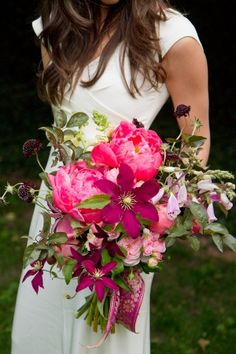 Bold toned bouquet with coral peonies and baroque ribbon