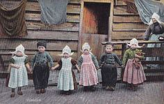 "Dutch babies - ""wooden shoe"" like to pinch their cheeks?  #Dutch Children #Wooden Shoes #Holland #Vintage Photos"