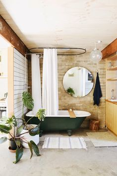 I love how this bathroom is styled even though the surrounding are rather ... hmmm. stripped. (my scandinavian home)