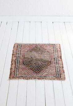 vintage rug on white floor