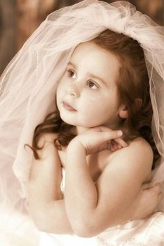 Young girl wearing mothers wedding dress beloit wisconsin lisa karr photography