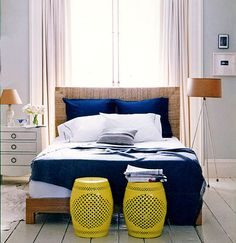navy blue, grey and  yellow are our colours for the master bedroom; we are putting the wood accents on the floor though, and the blue on the walls, and the grey in the linens.  The yellow will be furniture/decor.