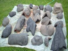 Faux boulders: paperback wire lath...bend it beat it to shape, then plaster it with trinity white cement with the stain of your choice mixed in; or: boxes covered with garbage bags, then covered with chicken wire, then covered with about 3 inches of pigmented hypertufa (portland cement, sand, peat moss mix). Gardenweb has a hupertufa forum that is interesting.