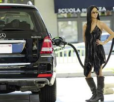 A lesson in how to look cool wile filling up your car with gas byNicole Scherzinger  in her Mercedes Benz BlueTEC