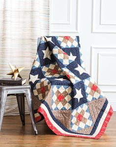 This Quilt of Valor combines an appliquéd star block and an album quilt block. The red, cream and blue borders finish off the patriotic quilt. The inspiration for this quilt was an antique quilt in Sue Reich's book World War II Quilts.