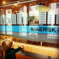 4 year old studying giant Emma Maersk scale model, at the Maersk HQ in Copenhagen.