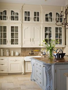 Lovely cabinets and gorgeous blue island.
