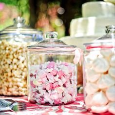 Set up a custom candy bar with your favorite sweets using glass canisters.