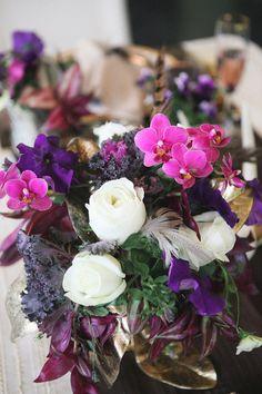 purple floral arrangement // photo by Sarah McAffry // http://ruffledblog.com/luxe-winter-wedding-ideas