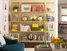 An Interview with Elaine Griffin. Love the yellow book shelves with blue chairs.