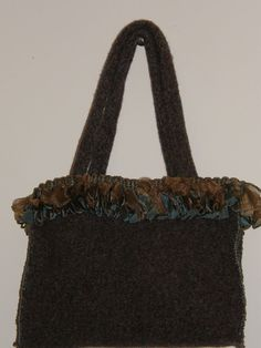 Densely felted Teal Brown purse with teal brown trim. Added accents.