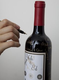 guest book wine bottles...guests sign on bottles and then bride and groom drink the bottles on special anniveraries!
