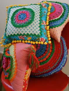 colourful cloth and crochet cushions. via Etsy.