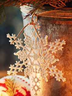 It's All in the Details: Embellish a simple galvanized sap bucket with humble hemp twine and an inexpensive snowflake ornament. Wrap twine several times around the top of bucket, then tie together and create a loop to thread snowflake on. Tie one more knot to secure the snowflake.