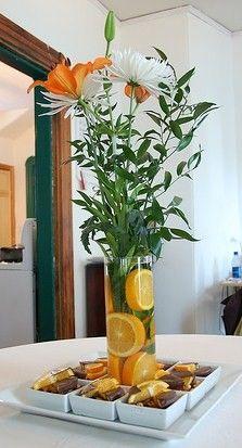 Centerpiece using oranges grapefruit party theme orange lemon lime tangerine yellow green decor