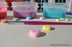 have leftover or just a plentiful stash of conversation hearts? Make paint & use them to get creative! LOVE this idea