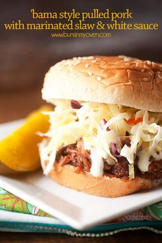 Pulled pork sandwiches topped with marinated slaw and white BBQ sauce