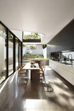 narrow kitchen layout, island and dining table in line