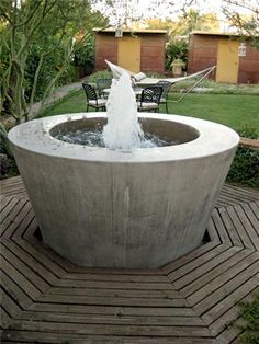 The clean lines on this poured concrete water feature contrast nicely with the sense of motion the water brings. By mrGSpace Landscape of Phoenix.