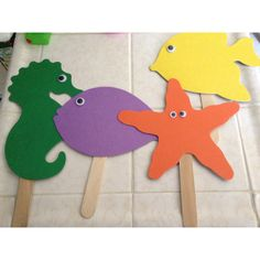 These are puppets I made from cut outs, googly eyes and craft sticks all bought at lakeshore learning center. At her party the kids will color these cut outs with markers (yes...the washable kind!) and have an ocean puppet show!