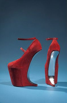 Red suede shoes by Nina Ricci.