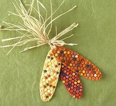 Bubble Wrap Indian Corn.  Paint long ovals of bubble wrap on the back with the base color.  When dry, flip over the corn cobs, and use q-tips to paint the individual niblets random colors.  Mount onto cardstock backings, tie on some raffia, and you have a cute little decoration. #bubblewrap