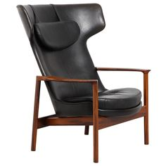 Ib Kofod-Larsen; Rosewood and Leather Lounge Chair for Carlo Ghan c1954.