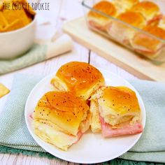 Baked Ham & Swiss Sliders with honey dijon and poppyseed dressing.  YUM! {The Cookie Rookie}
