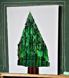 Christmas Tree Melted Crayon Art is a totally unexpected kids' Christmas craft! I love finding new ways to use old crayons.